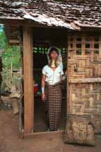 Jpeg 58K Padaung woman at the door of her house 8812j01